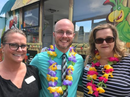 Kim Layton, (left) Derek Burton (middle), fromMeadow Brook Assisted Living and Memory Care); and Bridget Wetterer, (right) from Home Services Unlimited.